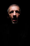 Grey haired man with opened mouth and scaring look Royalty Free Stock Photos