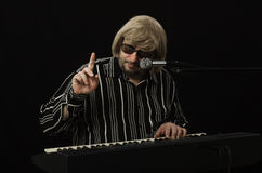 Grey haired musician pointing somebody Stock Photography