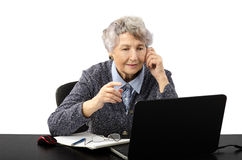 Grey haired teacher having online lesson by skype Royalty Free Stock Photography