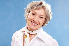 Grey-haired woman. Portrait of stylish woman grey haired looking at camera Royalty Free Stock Photos