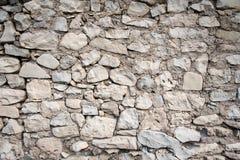 Grey hand built stone wall Stock Photo