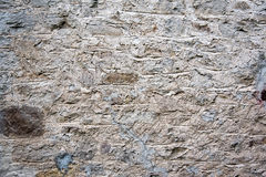 Grey hand built stone wall Royalty Free Stock Photography