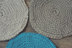 Grey handmade cottoncord tablecloths on crochet hook Royalty Free Stock Images
