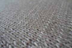 Grey handmade plain knit stitch fabric Royalty Free Stock Photos