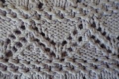 Grey handmade zigzag knitted openwork from above Stock Image