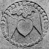 Grey heart with wings made of stone Stock Photography