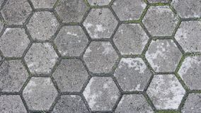The Grey hexagon pattern of the tile floor stock images