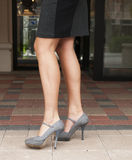 Grey High Heels and Black Skirt. Gray and Black Skirt and Gray High Heels Royalty Free Stock Images