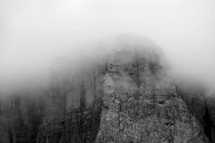 Grey High Rise Mountain Foggy during Daytime Stock Photography