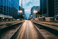 Grey Highway Between High Rise Building Royalty Free Stock Image