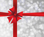 Grey holiday's background with red bow Stock Photo
