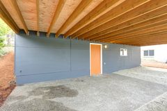 One story Home exterior with garage. Grey Home exterior with outdoor garage space stock images
