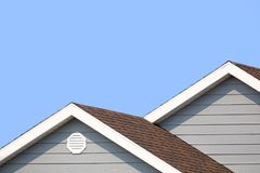 Grey house and blue sky Royalty Free Stock Image