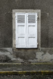 Grey house white shutters yellow no parking curve Stock Photography