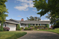 Grey house with wide driveway Stock Images