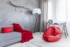 Grey interior with red sack chair Stock Photos