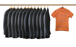 Grey jackets and orange t shirt hanged Stock Photography
