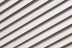 Grey jalousie diagonal background. Grey office style jalousie textured background stock photos