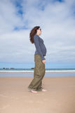 Grey jersey pregnant walking at beach Stock Photography