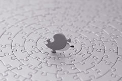 Grey jigsaw with the last piece upstanding Royalty Free Stock Photo