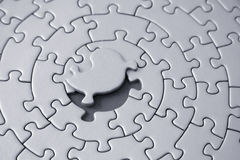 Grey jigsaw with the missing piece laying above the space. Pieces fitting together in form of a spiral - adobe RGB Stock Photos