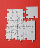Grey jigsaw with the missing piece laying aside Royalty Free Stock Photography