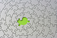 Grey jigsaw with one missing piece. Pieces fitting together in form of a spiral - adobe RGB Royalty Free Stock Photos