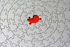 Grey jigsaw with one missing piece Royalty Free Stock Photos