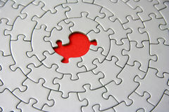 Grey jigsaw with one missing piece Stock Photo
