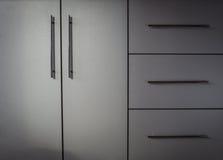 Grey kitchen cabinet Royalty Free Stock Image