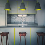 Grey kitchen with three chairs Royalty Free Stock Images