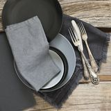 Grey kitchen utensils on rough distressed wooden table Stock Image