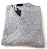 Grey knit sweater folded on white background Royalty Free Stock Photography
