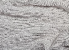 Grey knitted curve texture Stock Image