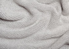 Grey knitted curve texture Royalty Free Stock Photography