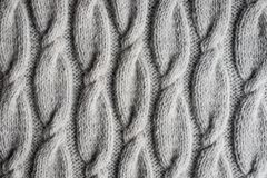 Grey knitted fabric texture, top view stock photo