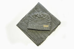 Grey knitted hat and scarf Royalty Free Stock Images