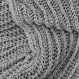 Grey knitted pullover background. Close up grey knitted pullover background Stock Photo