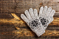 Grey knitted winter gloves Royalty Free Stock Photo