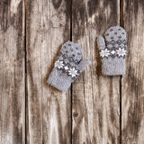 Grey knitted winter gloves Royalty Free Stock Photos