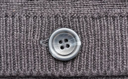 Grey knitted wool with button Royalty Free Stock Photo