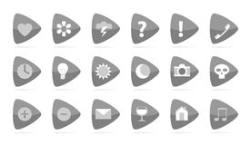 Grey labels with symbols. Labels with symbols, 18 grey triangles on white Stock Photography