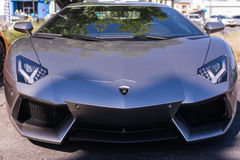 Grey Lamborghini on exhibition parking at an annual event Superc Stock Photo