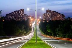 Grey Lamp Port Between Grey Concrete Road Stock Image