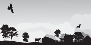 Grey landscape with trees and village.  Stock Photography