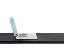 Grey laptop on black table Royalty Free Stock Photos