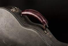 Grey leather case for mandolin on black background. Grey leather case for mandolin on black background stock image