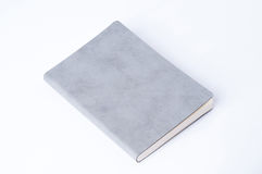 Grey leather notebook isolated on white background. Royalty Free Stock Images