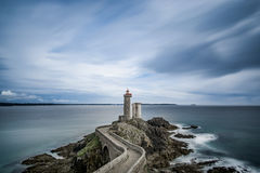 Grey Lighthouse and Ocean Painting Royalty Free Stock Image