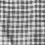 Grey linen crumpled tablecloth. Royalty Free Stock Photos